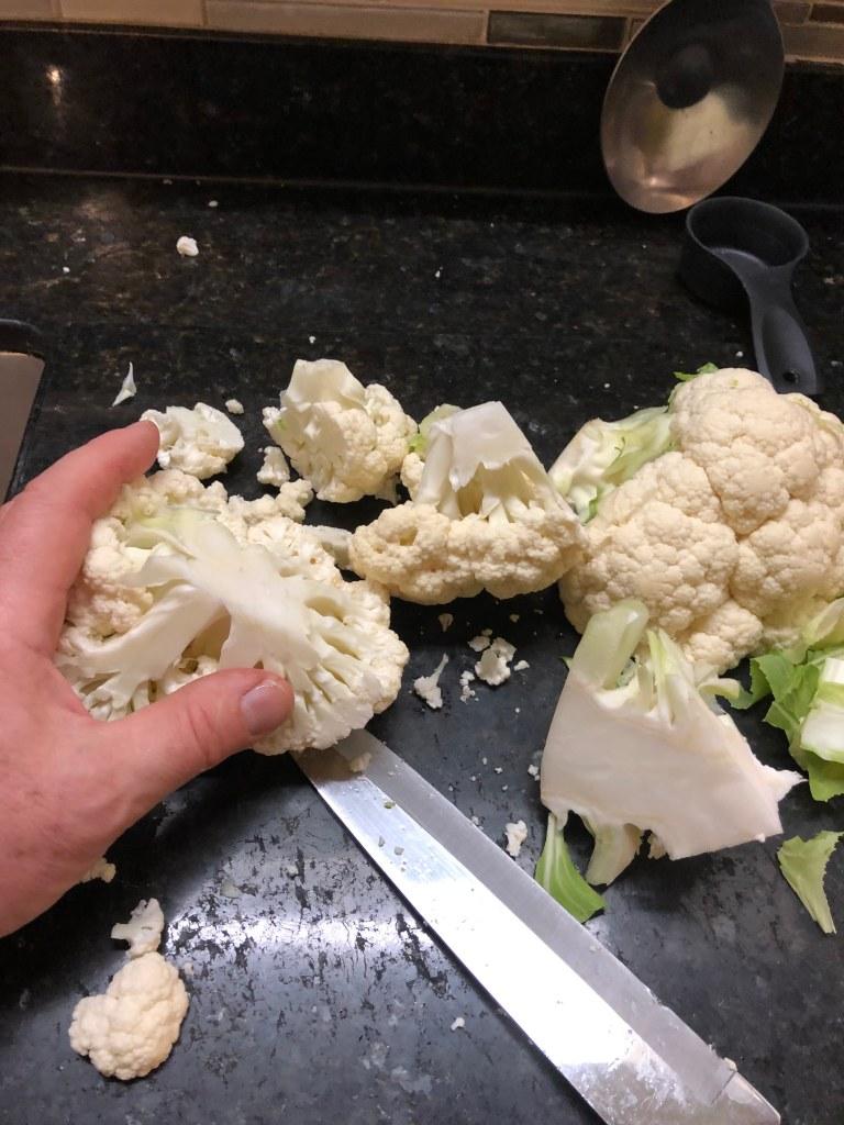 Chop the cauliflower into chunks