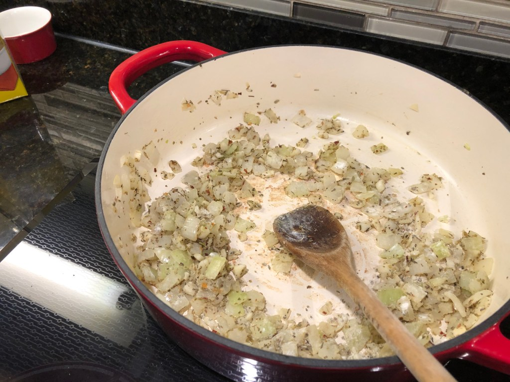 In a large pot over medium heat, melt butter add onion and cook until translucent, about 3 minutes. Add garlic and cook until fragrant, about 1 minute more. Add Italian seasoning, red pepper flakes, and flour and whisk to combine.