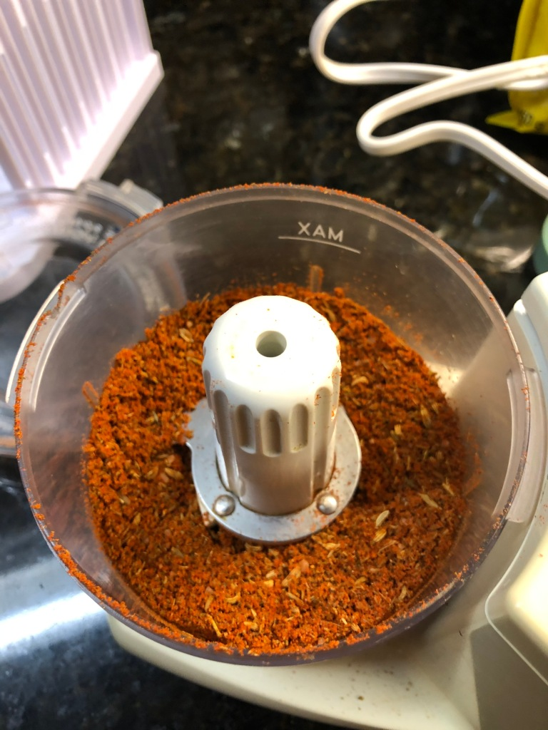 Toss the spic es into a MINI food processor and grind them together well