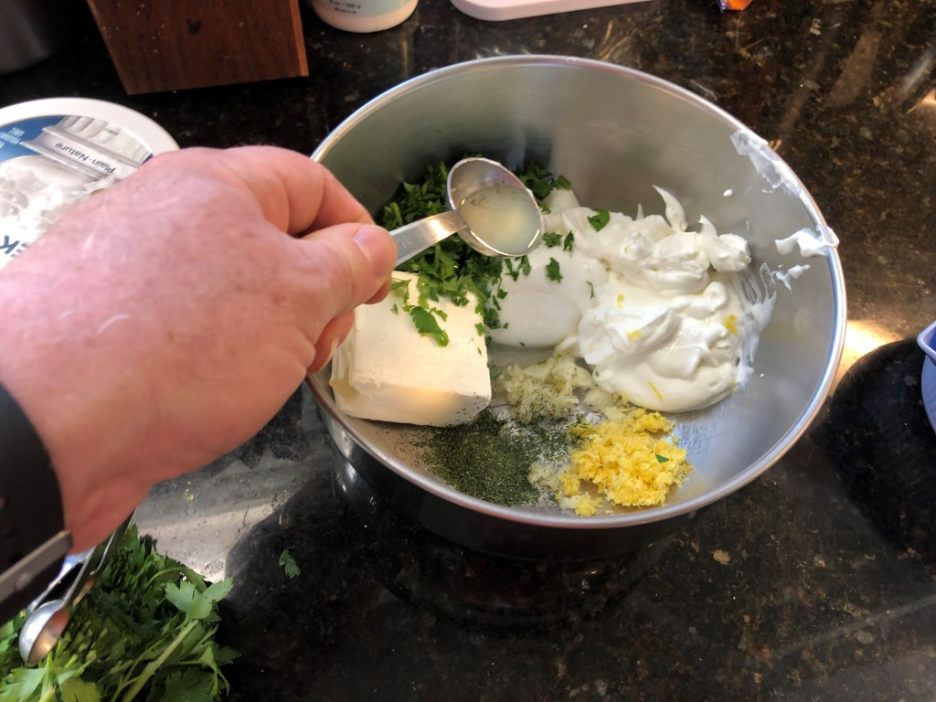 In a deep bowl add everything together: cream cheese, Greek yogurt, garlic, dill, lemon zest, parsley and lemon juice