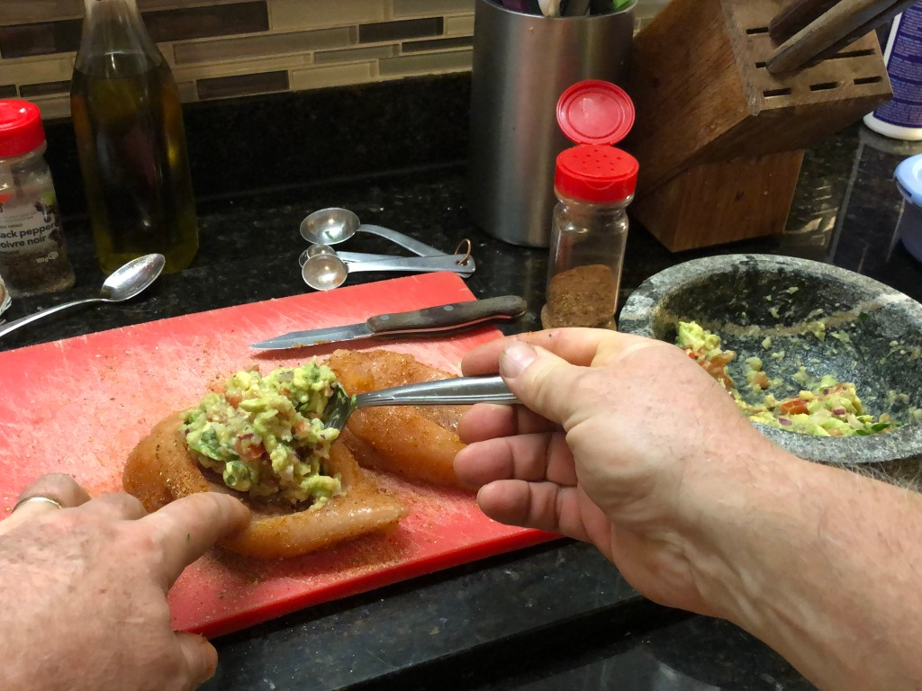 Using a teaspoon fill each pocket with guacamole to taste ( 1-3 tablespoons per pocket)