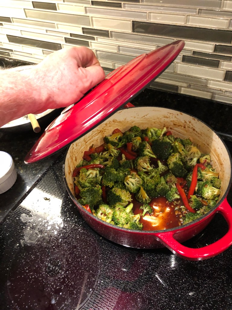 Reduce heat to medium low and add broccoli. Stir well, and cover to simmer for 5 or 6 minutes until tender