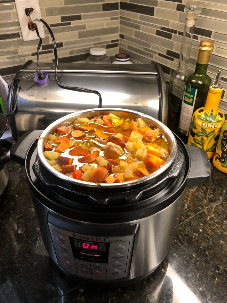 Once pineapple comes to a boil move to the pot, add carrots and peppers, cover and set to slow cook for 3 hours on high, 6 hours on low