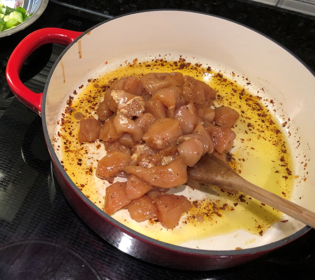 Cut chicken thighs into quarters and sprinkle with salt and pepper. Add 1 tbsp olive oil to a skillet and brown thighs