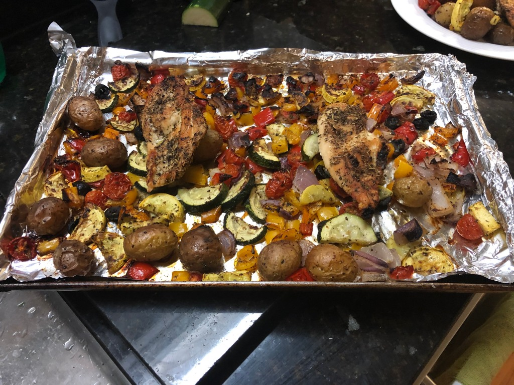 Bake 25 minutes then finish under the broiler for 5 minutes for  crispier veggies and chicken