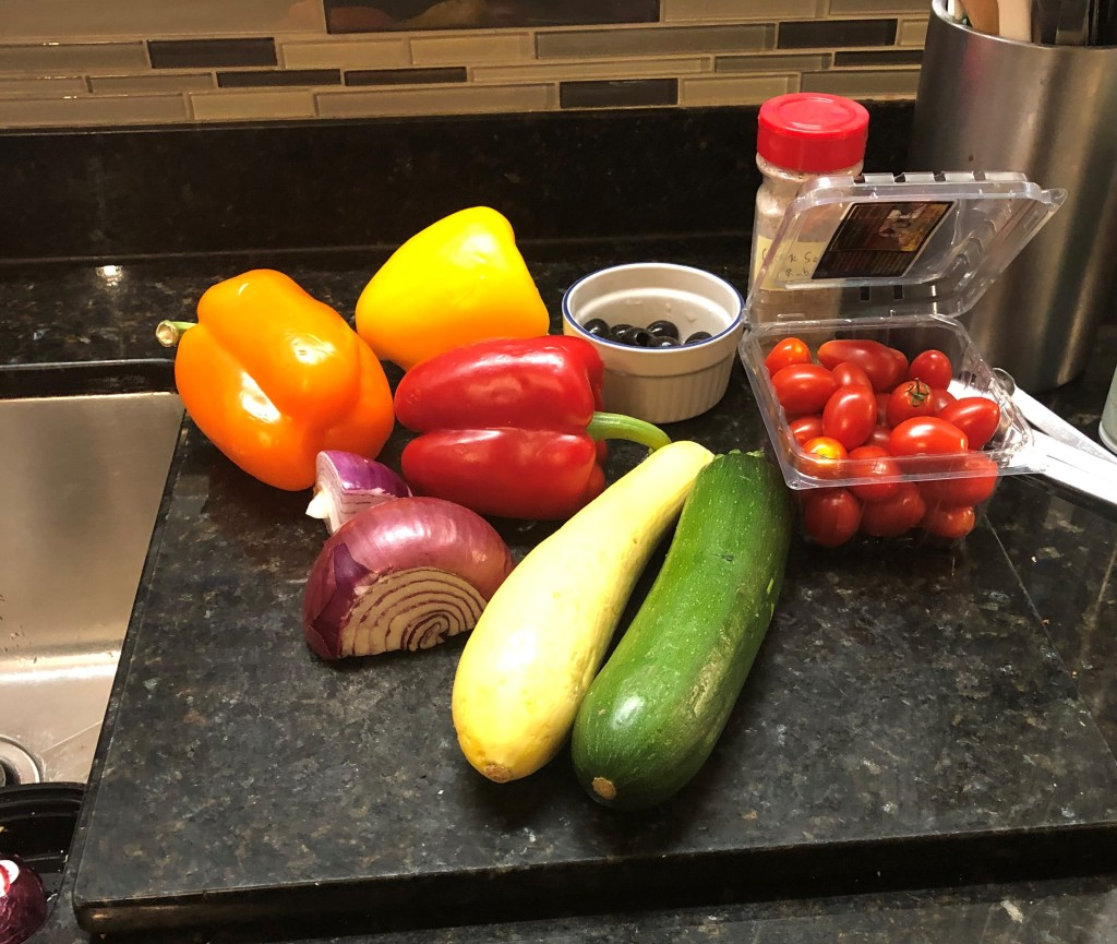 INGREDIENTS: chicken, bell peppers, zucchini, yellow squash, red onion, cherry tomatoes, black olives, new potatoes, Greek seasoning