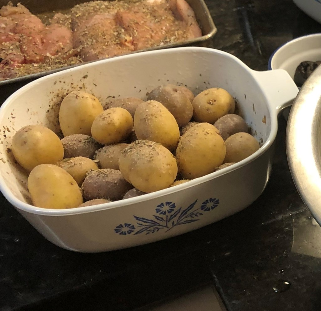 Toss the potatoes in a table spoon of oil and Greek seasoning. Add a table spoon of water, cover and microwave for 2 minutes to parboil the potatoes. This will ensure they are not under cooked when everything else is ready