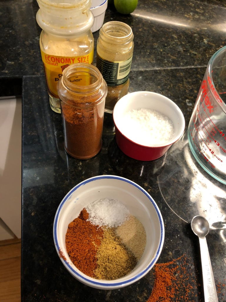 Start by preheating your oven to 425°.  Combine Chili Powder with Cumin, Garlic Powder and Kosher Salt...
