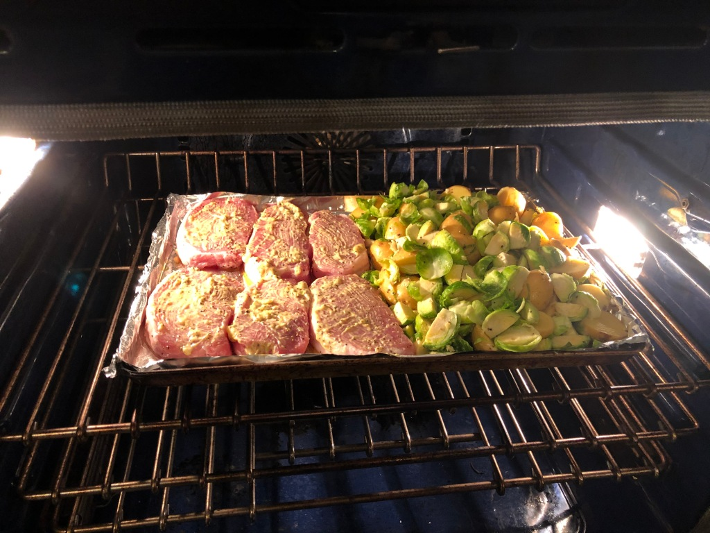 Bake for ten minutes then turn the chops carefully brushing the newly exposed side with remaining mustard sauce. Also, stir the veggies and continue to bake for 10' to 15 minutes