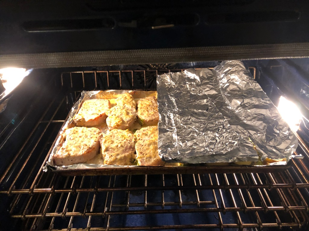 Cover the veggies with a sheet of foil to protect them... then turn on the broiler to finish browning the chops.