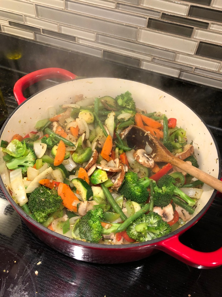 Start with 1 tbsp oil then add onion for two minutes, then garlic for 30 seconds… follow by celery, peppers, carrots and broccoli for 3 minutes...  then the rest of the spices, stir well then add mushrooms for 3 minutes...