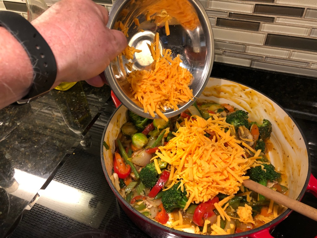 ... add shredded cheddar and thoroughly mix it in...