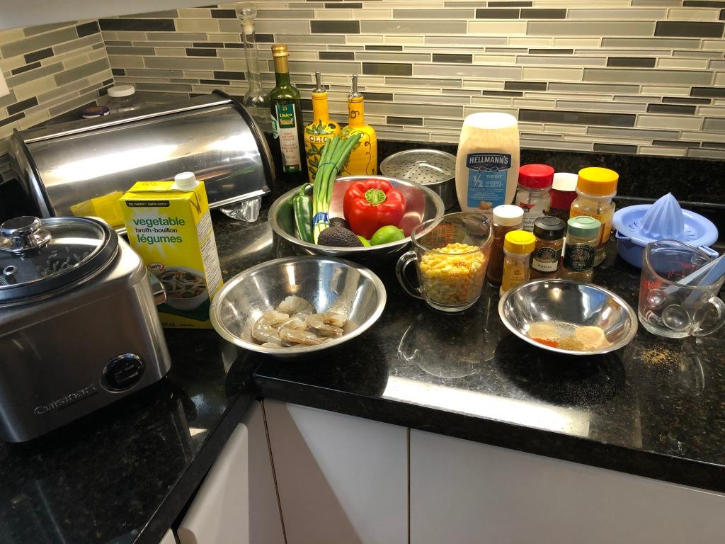 Combine shrimp, olive oil, Cajun Spice Rub, street corn, avocado, brown rice