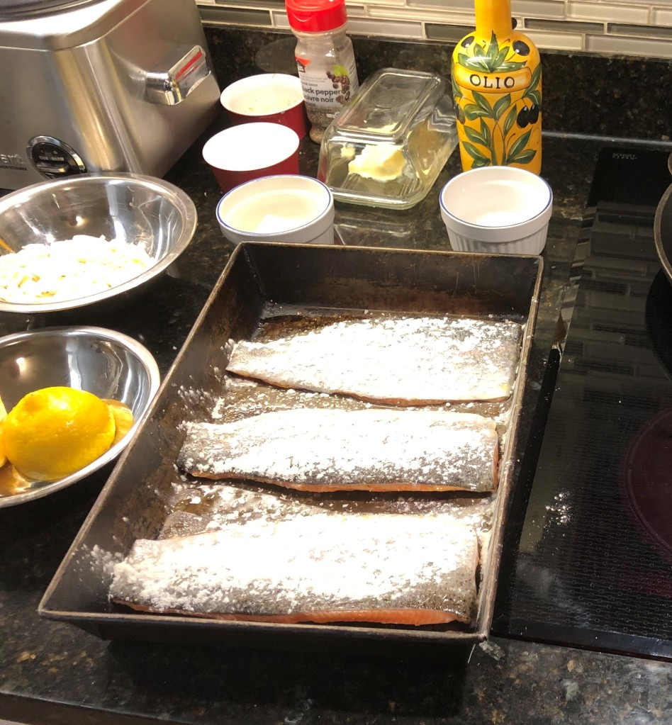 Sprinkle both sides of trout with salt and pepper, drizzle with olive oil,  then dust the skin side with flour