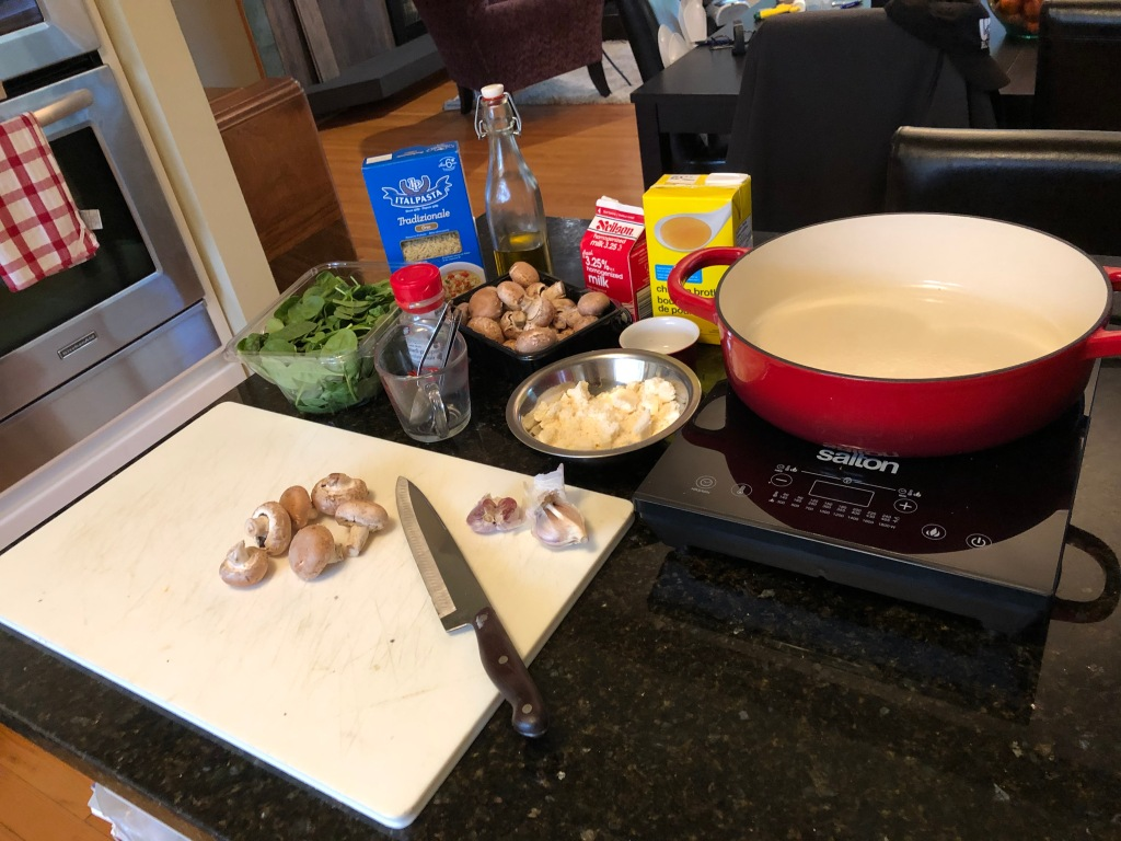 Orzo, mushrooms, spinach, garlic, Parmesan, chicken stock and milk all together create a delicious meatless main course