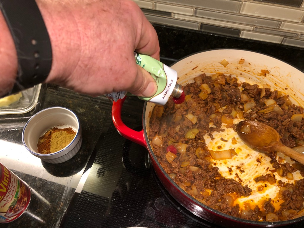 Add the tomato paste and thoroughly stir it in