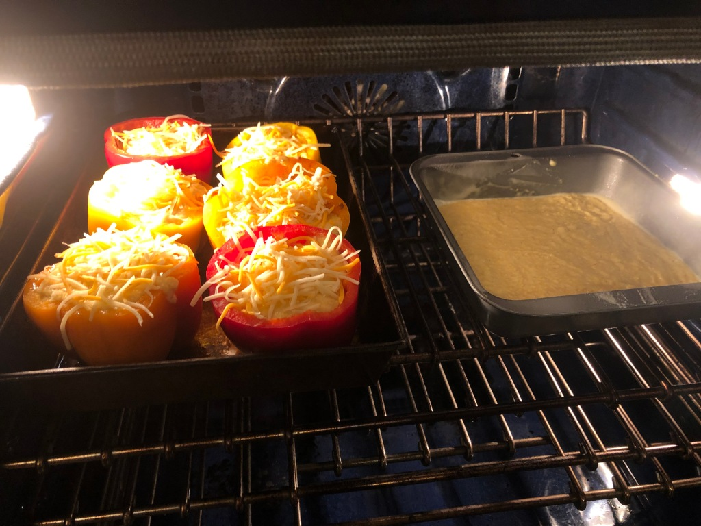 Top with another layer of cheese, cover with foil the pop it in the oven