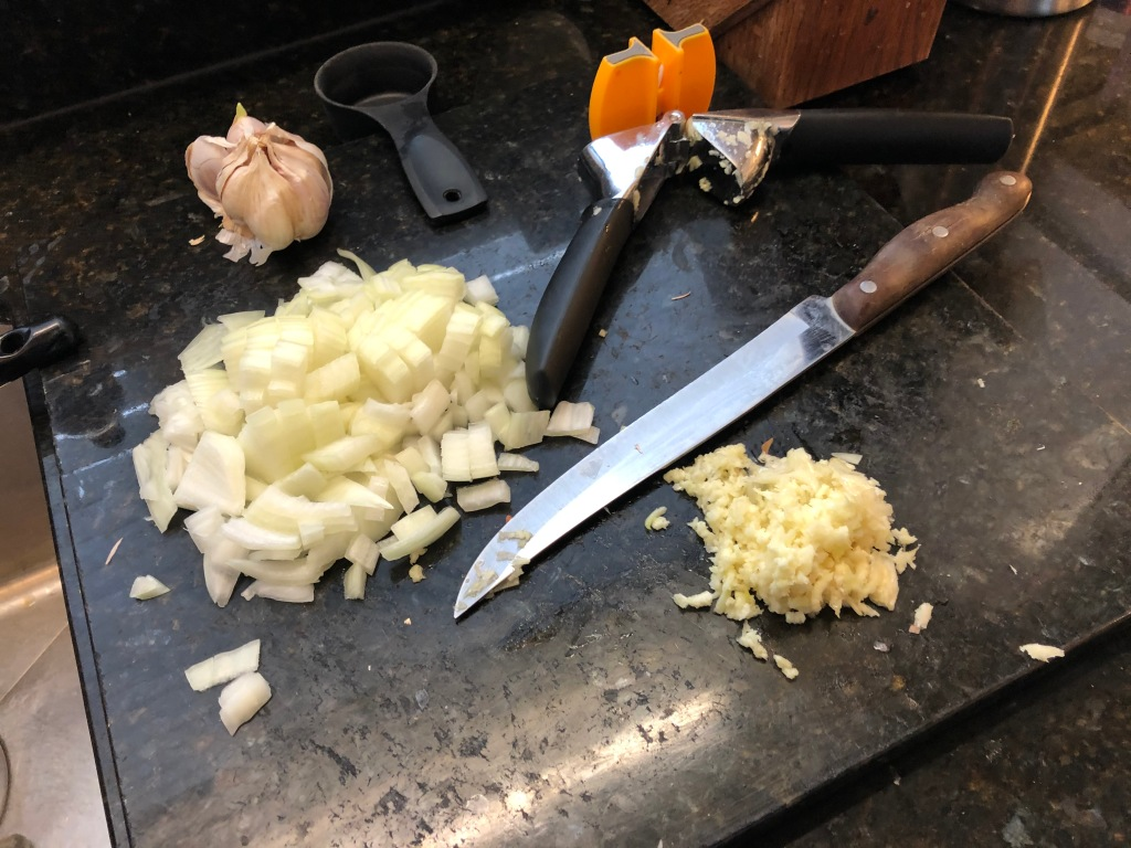 Pre chop onion and mince garlic