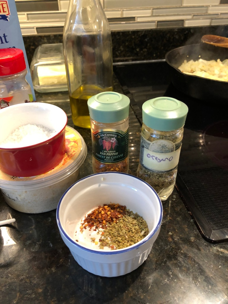 Pre-measure red pepper flakes and dried oregano and have it ready in a ramekin
