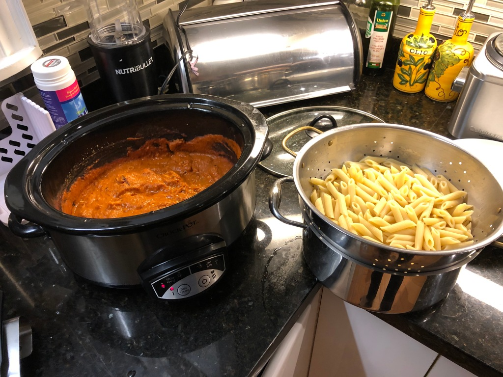 Stirring the pasta into the sauce is actually a good Veteran Move. It's called emulsifying and it adds terrifically to the final flavour