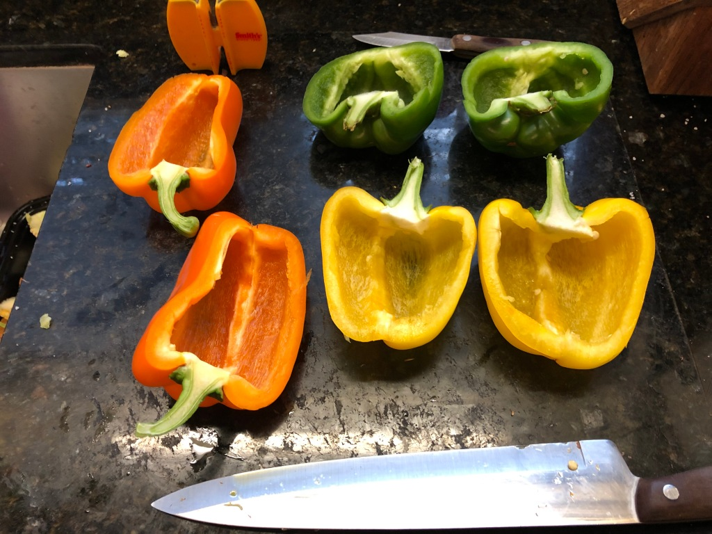 Start by slicing each bell pepper in half...