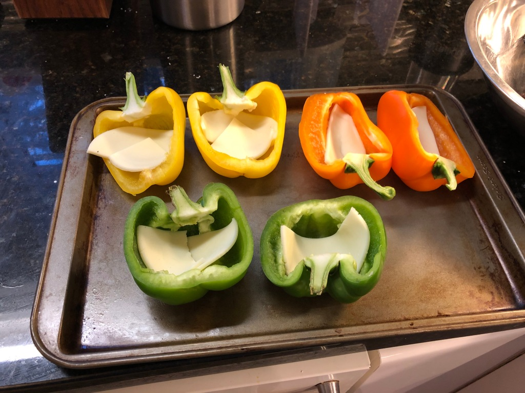 Preheat the oven to 400 degrees... I cut the provolone slices in half to make it easier to line the inside each pepper
