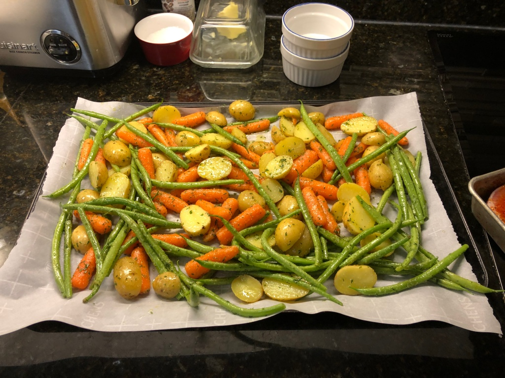Arrange the veggies to lay as flat as possible on the sheet pan and...