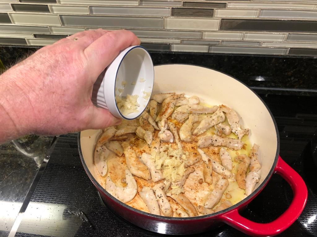 Turn the heat down to medium and add the garlic