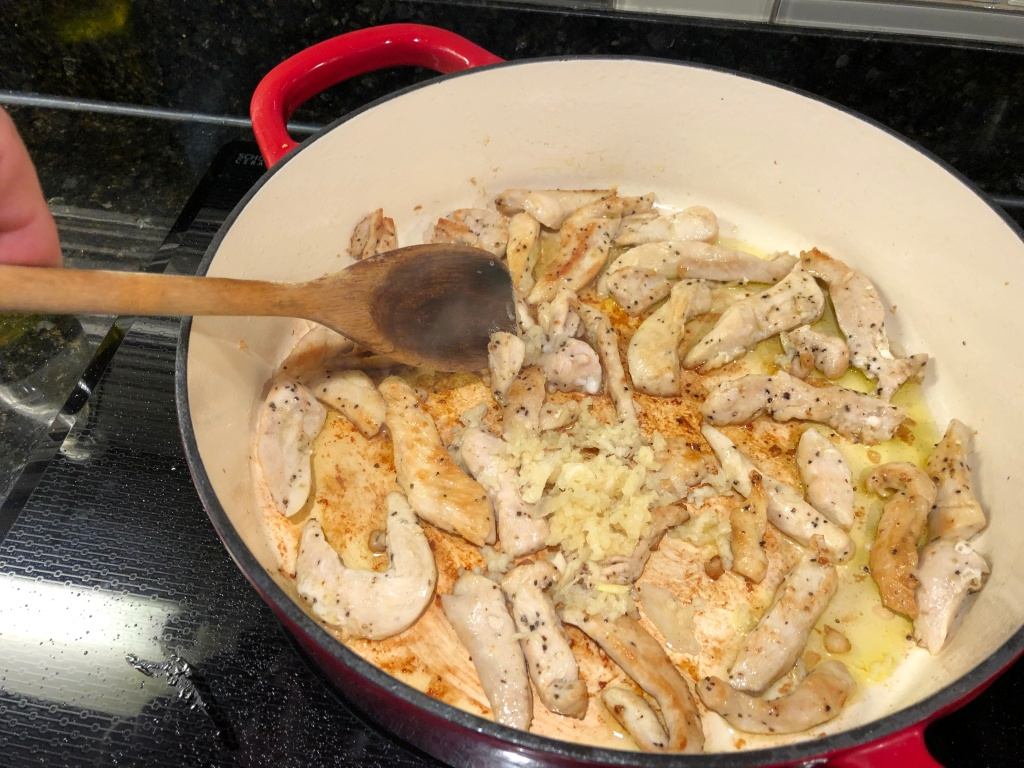 Add the garlic and stir into the cooked chicken for 30 seconds to 1 minute