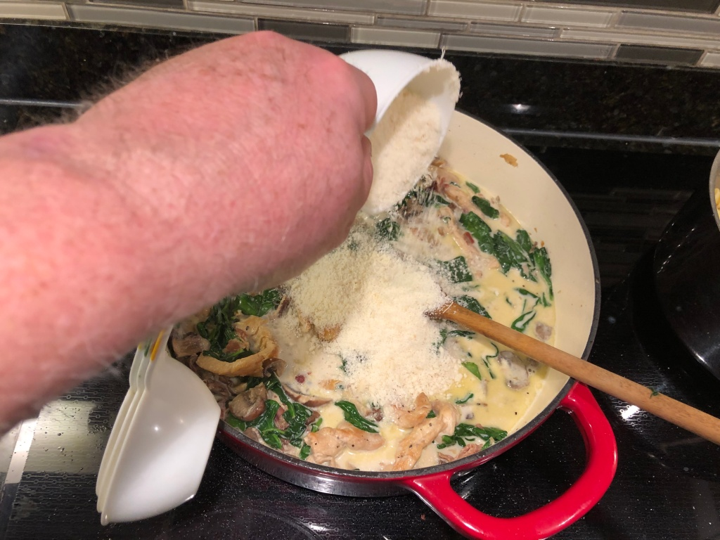 Then, add the Parmesan and mix it thoroughly into the chicken