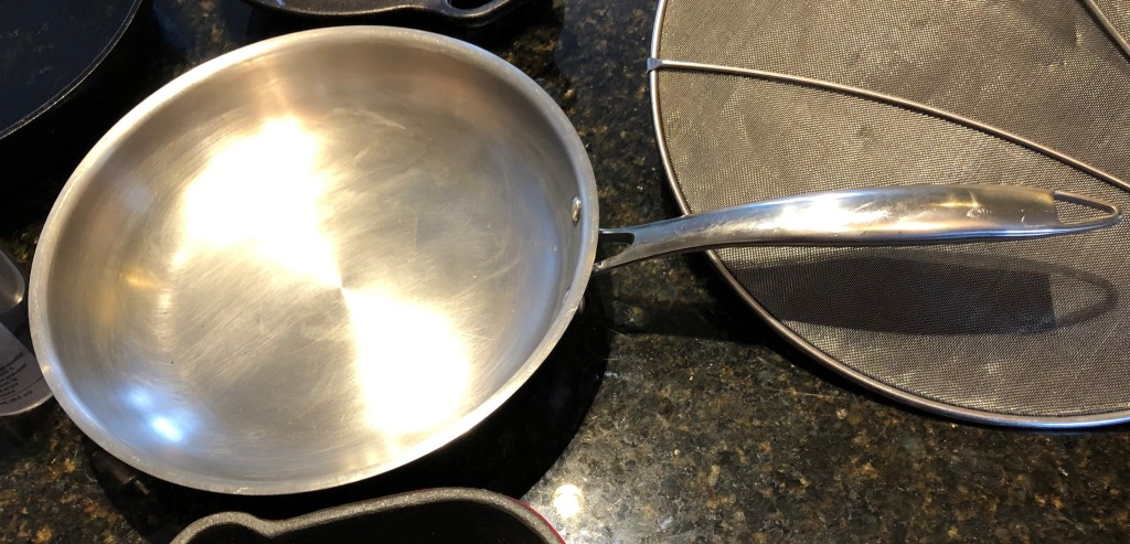 Stainless steel skillets can be used to sear meats and create crispy finishes because they can be used at high heat.