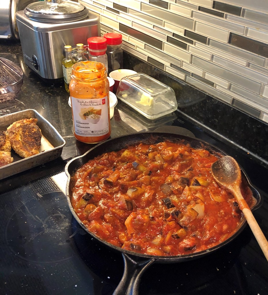 Thoroughly stir the sauce into the eggplant mixture and bring to a boil