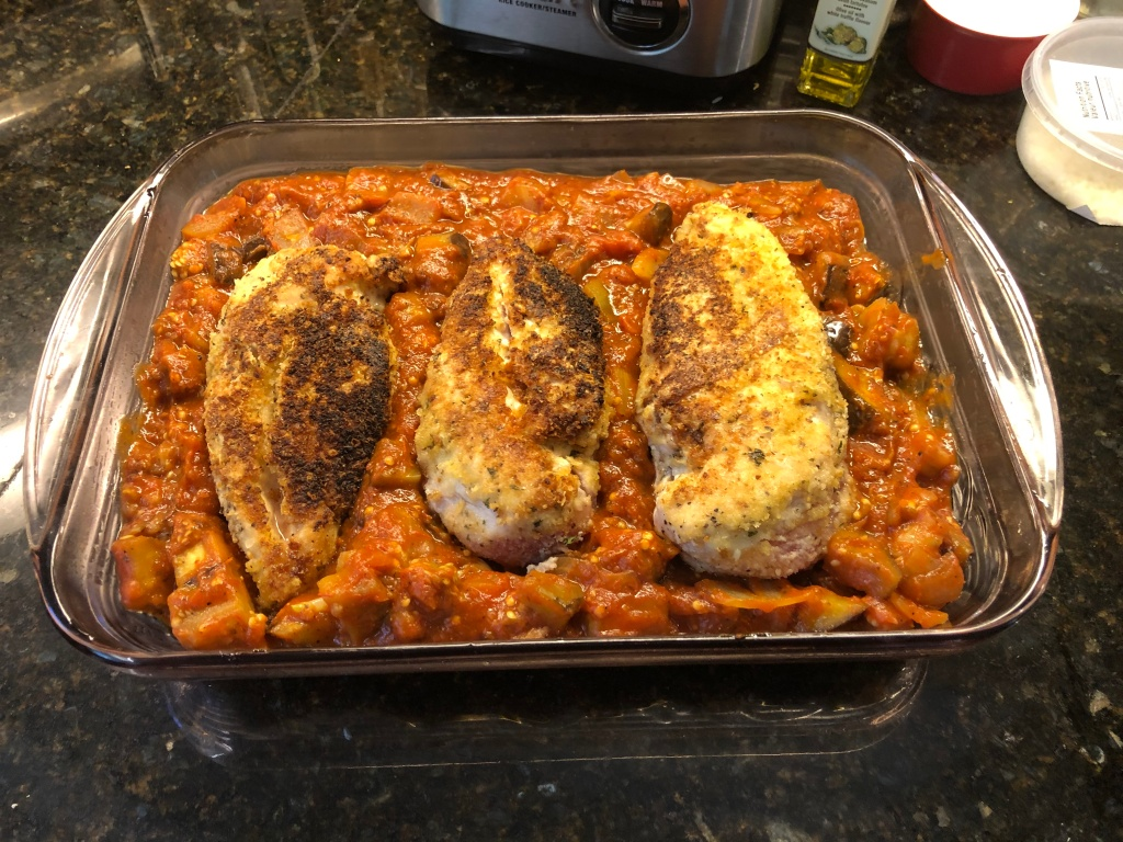top the sauce with the chicken breasts